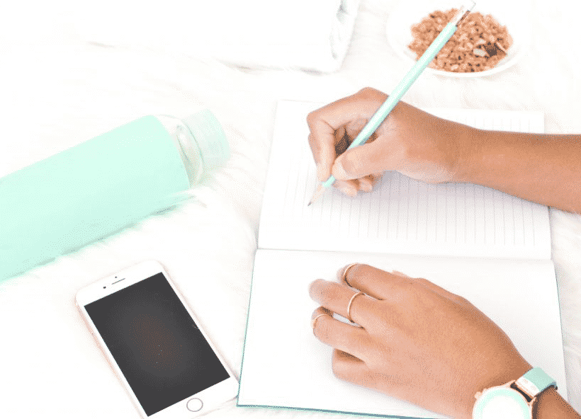 woman writing in journal about managing chronic illness and work