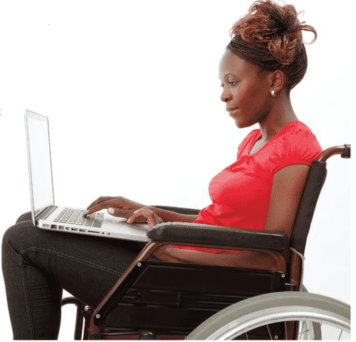 woman in wheelchair with a laptop on lap typing