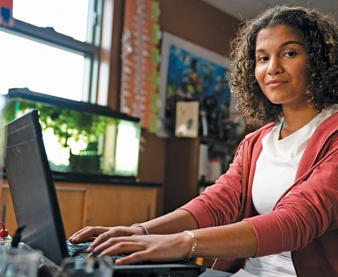 woman using computer with internet access smiling