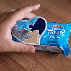 childs hand holding a special Rice Krispies treat