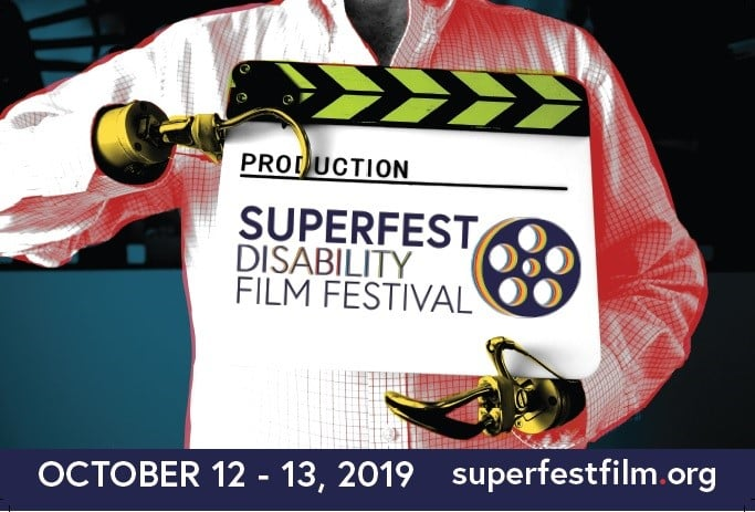 Man with prosthetic hand holds up sign for Superfest Disability Film Festival