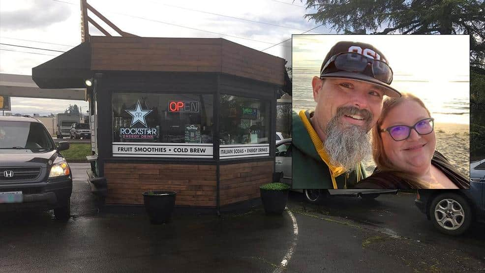 Coffee shop owner and his wife are pictured smiling next to their drive thru coffee shop