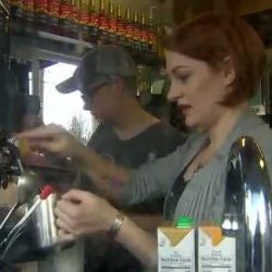 coffee shop owner is pouring a cup of coffee alongside competitor