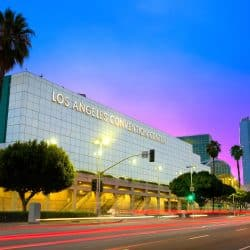 Los Angeles Convention Center for the Abilities Expo is pictured with blue skies and palm trees