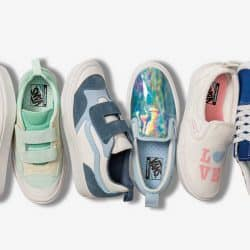 six different styles of Vans shoes lined up in a row