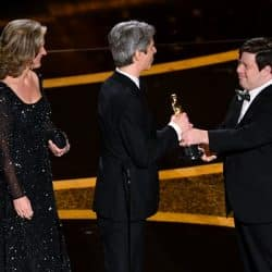 Zack Gottsagen receiving an academy award for his movie, Peanut Butter Falcon