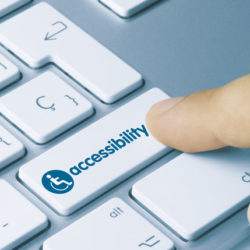 A man's finger on keyboard key that says Accessibility