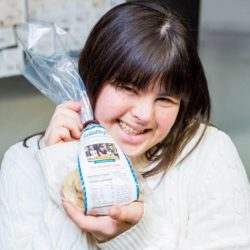 Collette Divitto holding a bag of her cookies