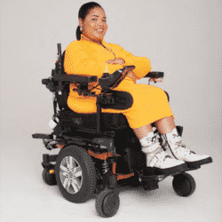 woman dressed in all yellow seated in a LUCI wheelchair