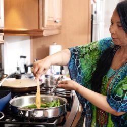 Chef Regina Mitchell prepares vegetables in her home outside of Las Vegas. Mitchell, who is blind, teaches Zoom cooking classes through the Nevada-based organization Blindconnec