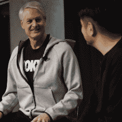 John Donahoe, CEO of Nike wearing a gray hoodie while seated in an interview