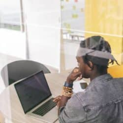 mental health can impact work. Man sitting in front of computer working