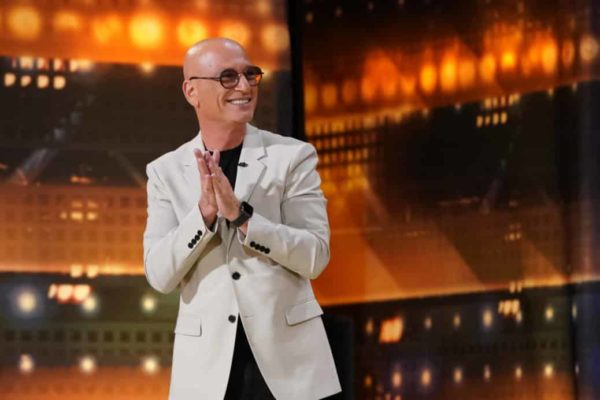 Howie Mandel on stage smiling away from the camera