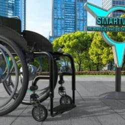 'Smart Wheel', a motorised wheel which can be added to most wheelchairs and provides users with assistance on uneven ground, elevation and on long journeys. The wheel can be controlled from the user's phone.