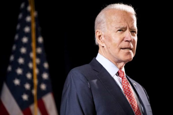 Biden pictured with the american flag. The Biden administration on Monday released new guidance on how to support those experiencing long-term symptoms of COVID-19 as part of a broader effort to recognize the 31st anniversary of the Americans with Disabilities Act.