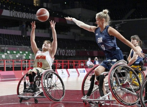 Japan's Yui Kitama (left) shoots during the first quarter of a women's wheelchair basketball preliminary-round game against the U.K. at the Tokyo Paralympics at Musashino Forest Sport Plaza on August 26, 2021. Credit: Getty Images
